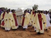 Clergymen carry white coffins containing the bodies of priests allegedly killed by Fulani herdsmen, for burial at Ayati-Ikpayongo in Gwer East district of Benue State, north-central Nigeria on May 22, 2018. - Two Nigerian priests and 17 worshippers have been buried, nearly a month after an attack on their church, …