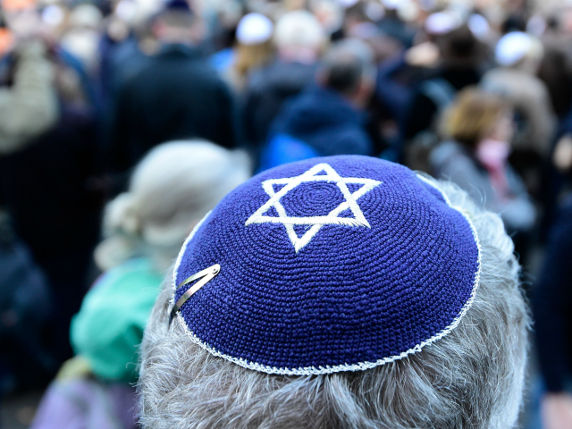 A participant of the 'Berlin wears kippa' rally wears a kippa in Berlin on April 25, 2018. - Germans stage shows of solidarity with Jews after a spate of shocking anti-Semitic assaults, raising pointed questions about Berlin's ability to protect its burgeoning Jewish community seven decades after the Holocaust. (Photo …