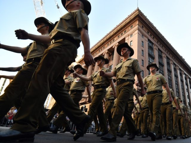 Participants march during the Anzac Day parade in Sydney on April 25, 2019. - Anzac Day marks the April 25, 1915 landing of Australian and New Zealand forces at Gallipoli on the Turkish peninsula in an ill-fated campaign against the German-backed Ottoman forces. (Photo by Saeed KHAN / AFP) (Photo …
