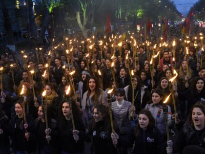 People take part in a torchlight procession as they mark the anniversary of the killing of 1.5 million Armenians by Ottoman forces, Yerevan, April 23, 2019. - Armenians commemorate on April 24, the 104th anniversary of the killing of 1.5 million by Ottoman forces, as a fierce dispute still rages …