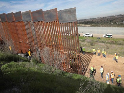 TIJUANA, MEXICO - JANUARY 28: Construction of the U.S. border wall is halted after a car rolled down an embankment and landed against the wall on the Mexican side of the border on January 28, 2019 in Tijuana, Mexico. The U.S. government had been partially shut down as President Donald …