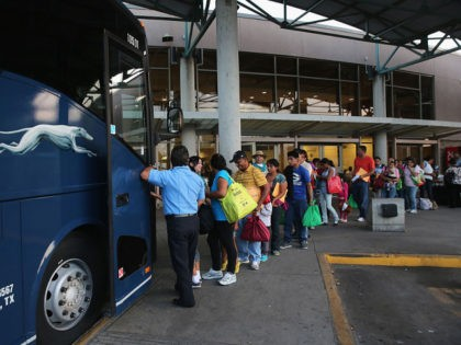MCALLEN, TX - JULY 25: Central American immigrants just released from U.S. Border Patrol detention board a Greyhound bus for Houston and then other U.S. destinations on July 25, 2014 in McAllen, Texas. Federal agencies have been overwhelmed by tens of thousands of immigrant families and unaccompanied minors from Central …