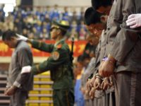 WENZHOU, CHINA: CHINA OUT Chinese police show of a group of hardcore convicts at a sentencing rally in the east Chinese city of Wenzhou 07 April 2004, where 11 prisoners were later executed for various crimes. Amnesty International has called for a moratorium on the death penalty in China, saying …