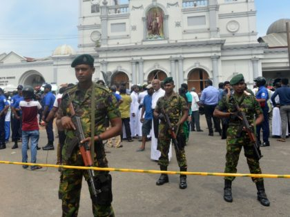 Sri Lankan security personnel keep watch outside the church premises following a blast at the St. Anthony's Shrine in Kochchikade in Colombo on April 21, 2019. - At least 137 people were killed in Sri Lanka on April 21, police sources told AFP, when a string of blasts ripped through …