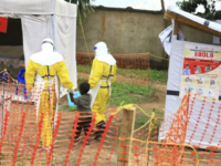 In this file photo dated Sunday, Sept. 9, 2018, health workers walk with a boy suspected as having the Ebola virus at an Ebola treatment centre in Beni, Eastern Congo. According to a WHO announcement Thursday Nov. 29, 2018, Congo's deadly Ebola outbreak is now the second largest in history, …