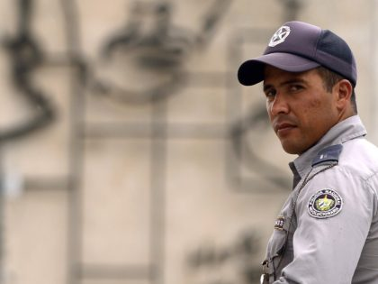 A policeman stands guard in central Havana's Revolution Square a day before Pope Francis' visit to Cuba on September 18, 2015. Havana has received a rush makeover ahead of Pope Francis's arrival in Cuba on Saturday with newly paved streets, a renovated cathedral, repainted buildings and billboards of the pontiff …