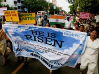 Indian Catholics walk with posters during an Easter procession in Kolkata, India, Sunday, April 21, 2019. Christians around the world are celebrating Easter commemorating the day when according to Christian tradition Jesus was resurrected in Jerusalem two millennia ago. (AP Photo/Bikas Das)