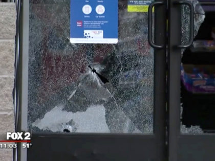 Gas station with broken glass from gunshot.