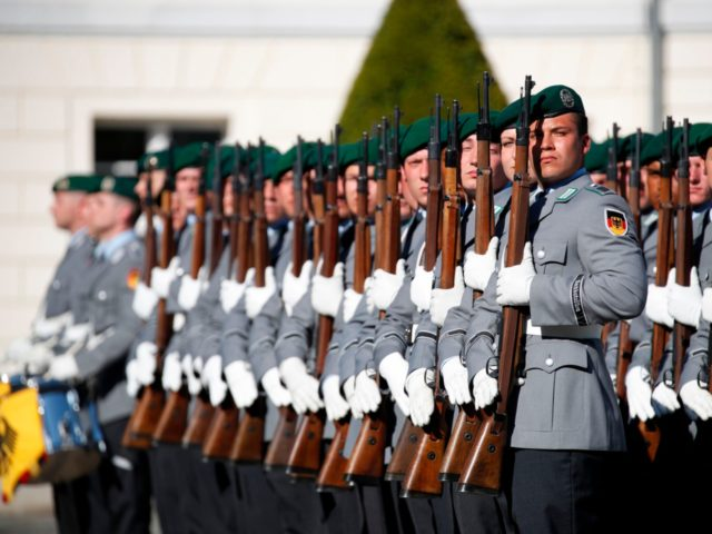 Soldiers of a German honor guard are pictured during a military ceremony for newly accredited US Ambassador Richard Allen Grenell in Berlin, Germany, on May 08, 2018. (Photo by Odd ANDERSEN / AFP) (Photo credit should read ODD ANDERSEN/AFP/Getty Images)