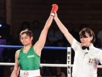 Iran's Sadaf Khadem (L) is designated as winner at the end of her amateur 3 rounds boxing match against France's Anne Chauvin (R) on April 13, 2019 in Royan, western France. - Sadaf Khadem became today the first Iranian woman to contest an official boxing fight. (Photo by MEHDI FEDOUACH …