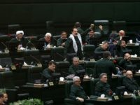 "Wearing the uniform of the Iranian Revolutionary Guard, lawmakers chant slogan during an open session of parliament in Tehran, Iran, Tuesday, April 9, 2019. Chanting ""Death to America,"" Iranian lawmakers convened an open session of parliament Tuesday following the White House's decision to designate Iran's elite paramilitary Revolutionary Guard a …"