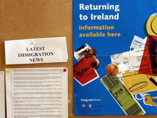 Yonkers, UNITED STATES: NUMBER OF ILLEGAL IRISH IMMIGRANTS IN US DWINDLING: A poster advertises information about returning to Ireland, 13 December, 2005, at the Aisling Irish Community Center in Yonkers, New York. While it is difficult to quantify the exact number of undocumented Irish immigrants in the country, it is …