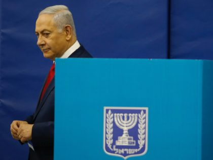 Israels Prime Minister Benjamin Netanyahu votes during Israel's parliamentary elections in Jerusalem, on April 9, 2019. - Israelis voted today in a high-stakes election that will decide whether to extend Prime Minister Benjamin Netanyahu's long right-wing tenure despite corruption allegations or to replace him with an ex-military chief new to …