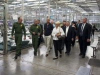 Border Patrol officers escort Homeland Security Secretary Jeh Johnson and Gov. Jan Brewer through the department's Nogales processing facility for immigrant children. (Photo courtesy Barry Bahler/Department of Homeland Security)