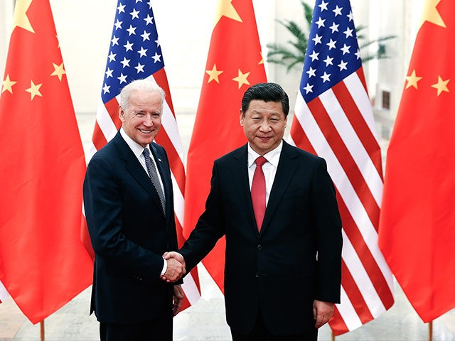 BEIJING, CHINA - DECEMBER 04: Chinese President Xi Jinping (R) shake hands with U.S Vice President Joe Biden (L) inside the Great Hall of the People on December 4, 2013 in Beijing, China. U.S Vice President Joe Biden will pay an official visit to China from December 4 to 5. …