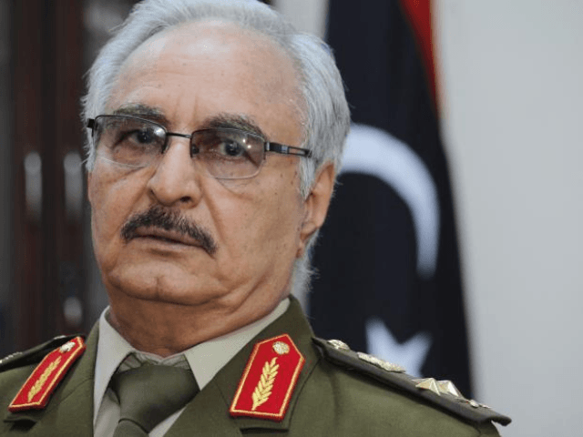 FILE -- In this March 18, 2015 photo file photo, Gen. Khalifa Hifter speaks during an interview with The Associated Press, in al-Marj, Libya. Hifter, a powerful Libyan general whose forces recently captured several key oil facilities has rejected a U.N.-brokered government and said the country would be better served …