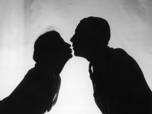 1st October 1926: A couple kissing in a scene from the play 'Just A Kiss' at the Shaftesbury Theatre, London. (Photo by Sasha/Getty Images)