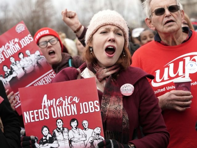 WASHINGTON, DC - FEBRUARY 26: Activists rally in front of the U.S. Supreme Court on February 26, 2018 in Washington, DC. The court is scheduled to hear the case, Janus v. AFSCME, to determine whether states violate their employees' First Amendment rights to require them to join public sector unions …