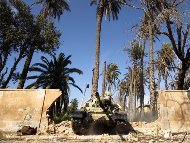 Members of the self-styled Libyan National Army, loyal to the country's east strongman Khalifa Haftar, hold a position in central Benghazi on July 6, 2017, after retaking the area from jihadist fighters. Libyan military strongman Khalifa Haftar on July 5 announced the 'total liberation' of second city Benghazi, which was …