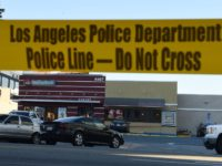 Police tape cordons off an area outside a Jack in the Box restaurant in Hollywood, California, January 31, 2017, after police shot and killed a knife-wielding suspect inside the restaurant following a series of stabbing in the vicinity. Authorities said a person described only as a male was pronounced dead …