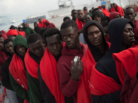 TOPSHOT - Migrants rescued at sea wait to be transferred at the harbour of Algeciras on August 1, 2018. - Spain has overtaken Italy as the preferred destination for migrant arrivals in Europe this year as a crackdown by Libyan authorities has made it more difficult for them to reach …