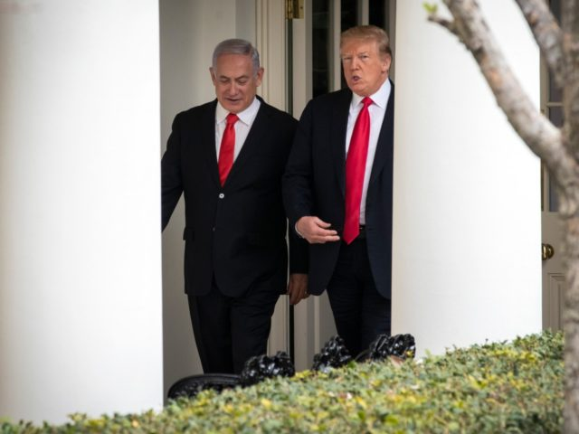 WASHINGTON, DC - MARCH 25: (L-R) Prime Minister of Israel Benjamin Netanyahu and U.S. President Donald Trump walk through the colonnade prior to an Oval Office meeting at the White House March 25, 2019 in Washington, DC. Netanyahu is cutting short his visit to Washington due to a rocket attack …
