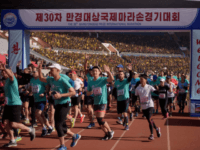 Foreign competitors cross the starting line during the annual 'Mangyongdae Prize International Marathon', at Kim Il Sung stadium in Pyongyang on April 7, 2019. - Twice as many foreigners as last year gathered in Pyongyang for the city's annual marathon, tour firms said, as reduced tensions see visitor numbers rise …