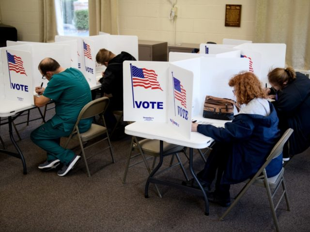 ZANESVILLE, OH - NOVEMBER 06: People cast their votes at the Central Trinity United Methodist Church polling location on November 6, 2018 in Zanesville, Ohio. Turnout is expected to be high nationwide as Democrats hope to take back control of at least one chamber of Congress. (Photo by Justin Merriman/Getty …
