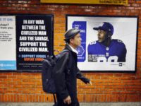 NEW YORK, NY - SEPTEMBER 27: People walk by a controversial ad, which has already been defaced, that condemns radical Islam in a New York subway station on September 27, 2012 in New York City. The ads, which are appearing in New York after a court case ruled in their …