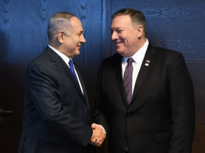 Israel's Prime minister of Benjamin Netanyahu (L) shakes hands with US Secretary of State Mike Pompeo as they talk to the press on the sidelines of a session at the conference on Peace and Security in the Middle east in Warsaw, on February 14, 2019. (Photo by Janek SKARZYNSKI / …