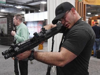 Thomas Larosa of Texas looks at a Standard Manufacturing Co. DP-12 double pump-action shotgun at the 2018 National Shooting Sports Foundation's Shooting, Hunting, Outdoor Trade (SHOT) Show at the Sands Expo and Convention Center on January 23, 2018 in Las Vegas, Nevada. The SHOT Show, the world's largest annual trade …