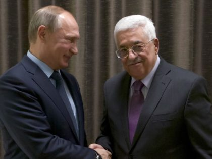 Russian President Vladimir Putin (L) shakes hands with his Palestinian counterpart Mahmud Abbas during a meeting at the Novo-Ogaryovo residence outside Moscow on September 22, 2015. AFP PHOTO / POOL / IVAN SEKRETAREV (Photo credit should read IVAN SEKRETAREV/AFP/Getty Images)