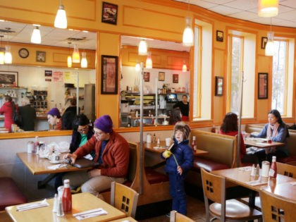 Customers sit in Little Purity restaurant in the Park Slope neighborhood in the Brooklyn borough of New York that Mayor-elect Bill de Blasio calls home, Thursday, Nov. 14, 2013. Now de Blasio faces a crucial early decision: should he leave Park Slope behind to move to the mayor's official residence, …