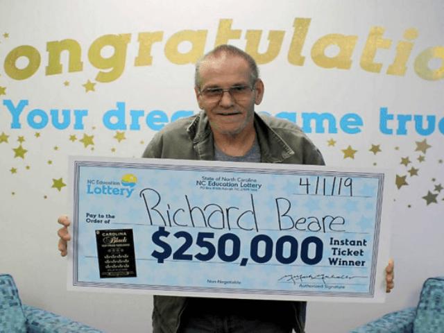 Richard Beare collects his big prize. North Carolina Education Lottery
