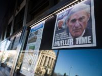 Newspaper front pages from around the nation are on display at the Newseum Saturday, March 23, 2019, in Washington. Special counsel Robert Mueller closed his long and contentious Russia investigation with no new charges, ending the probe that has cast a dark shadow over Donald Trump's presidency. (AP Photo/Alex Brandon)