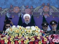 Iranian President Hassan Rouhani delivers a speech during a parade on the occasion of the country's Army Day on April 18, 2018, in Tehran. / AFP PHOTO / ATTA KENARE (Photo credit should read ATTA KENARE/AFP/Getty Images)