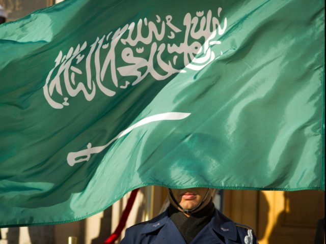 In this March 22, 2018 file photo, an Honor Guard member is covered by the flag of Saudi Arabia as Defense Secretary Jim Mattis welcomes Saudi Crown Prince Mohammed bin Salman to the Pentagon with an Honor Cordon, in Washington Saudi Arabia's Interior Ministry said Tuesday, April 23, 2019, that …