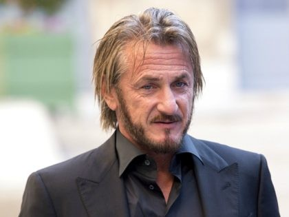 US actor Sean Penn listens to French minister for Ecology, Sustainable Development and Energy Segolene Royal at the ministry during a meeting to talk about the UN climate conference COP21 on November 1, 2015 in Paris. AFP PHOTO / LIONEL BONAVENTURE (Photo credit should read LIONEL BONAVENTURE/AFP/Getty Images)