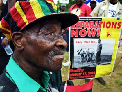 WASHINGTON, DC - AUGUST 17: Borneti Phillipis, 76-years-old, from Wackegan, Illinois, joins hundreds of black demonstrators for slave reparations on the National Mall August 17, 2002 in Washington, DC. Phillips traced back his ancestor, Robson, who was brought to the U.S. as a slave in 1786 from Uganda. (Photo by …