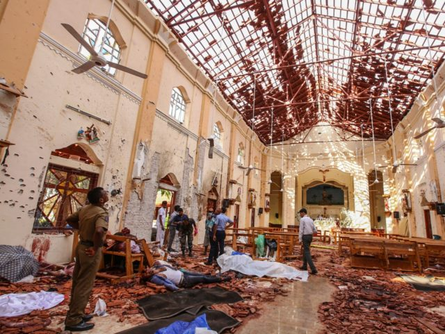 Dead bodies of victims lie inside St. Sebastian's Church damaged in blast in Negombo, north of Colombo, Sri Lanka, Sunday, April 21, 2019. More than two hundred people were killed and hundreds more injured in eight blasts that rocked churches and hotels in and just outside Sri Lanka's capital on …