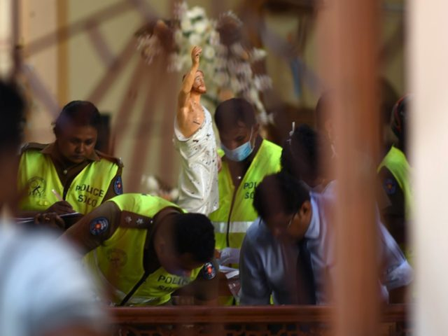 Security personnel inspect inside St. Sebastian's Church in Negombo on April 22, 2019, a day after the church was hit in series of bomb blasts targeting churches and luxury hotels in Sri Lanka. - The death toll from bomb blasts that ripped through churches and luxury hotels in Sri Lanka …