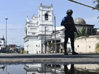 A security personnel stands guard near St. Anthony's Shrine in Colombo on April 24, 2019, three days after a series of bomb blasts targeting churches and luxury hotels in Sri Lanka. - The toll in a series of suicide bomb blasts on Easter Sunday targeting hotels and churches in Sri …