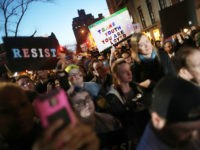 Hundreds protest a Trump administration announcement this week that rescinds an Obama-era order allowing transgender students to use school bathrooms matching their gender identities, at the Stonewall Inn on February 23, 2017 in New York City. Activists and members of the transgender community gathered outside the historic LGTB bar to …