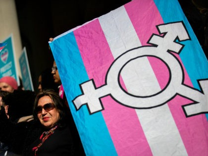 NEW YORK, NY - OCTOBER 24: L.G.B.T. activists and their supporters rally in support of transgender people on the steps of New York City Hall, October 24, 2018 in New York City. The group gathered to speak out against the Trump administration's stance toward transgender people. Last week, The New …