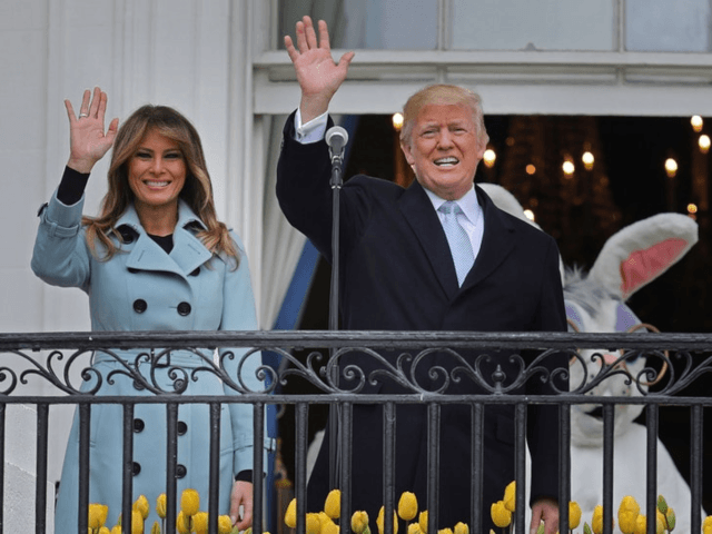 U.S. President Donald Trump (C) delivers remarks from the Truman Balcony with first lady Melania Trump during the 140th annual Easter Egg Roll on the South Lawn of the White House April 2, 2018 in Washington, DC. The White House said they are expecting 30,000 children and adults to participate …