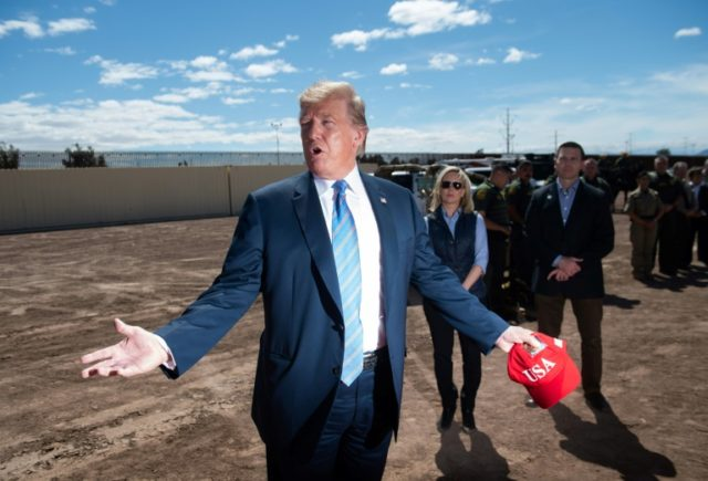 US President Donald Trump tours the border wall between the United States and Mexico in Calexico, California