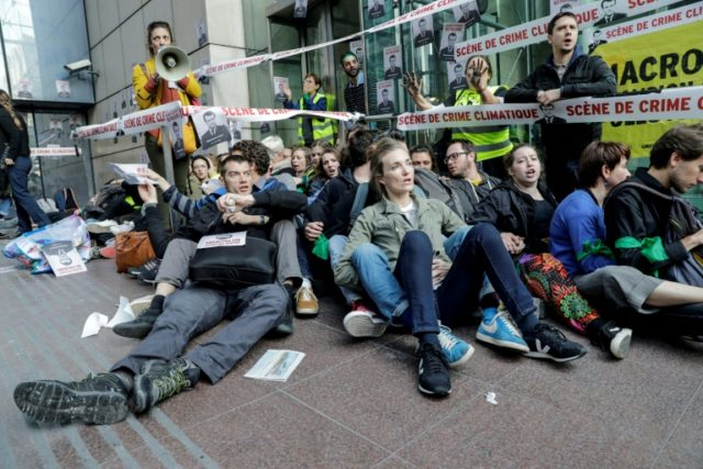 French climate activists in sit-in to denounce 'republic of polluters'