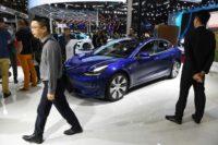 Tesla hit with big loss as car deliveries sputter