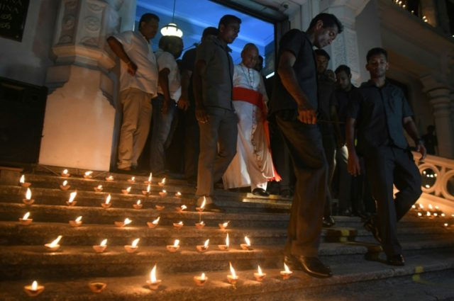 Tears and troops as Sri Lanka mourns suicide bomb dead