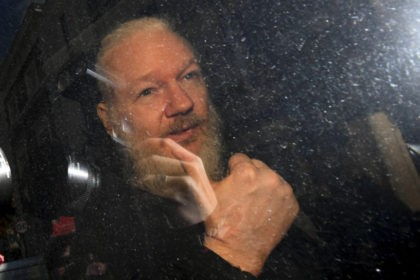 The Latest: US to announce charges against Assange